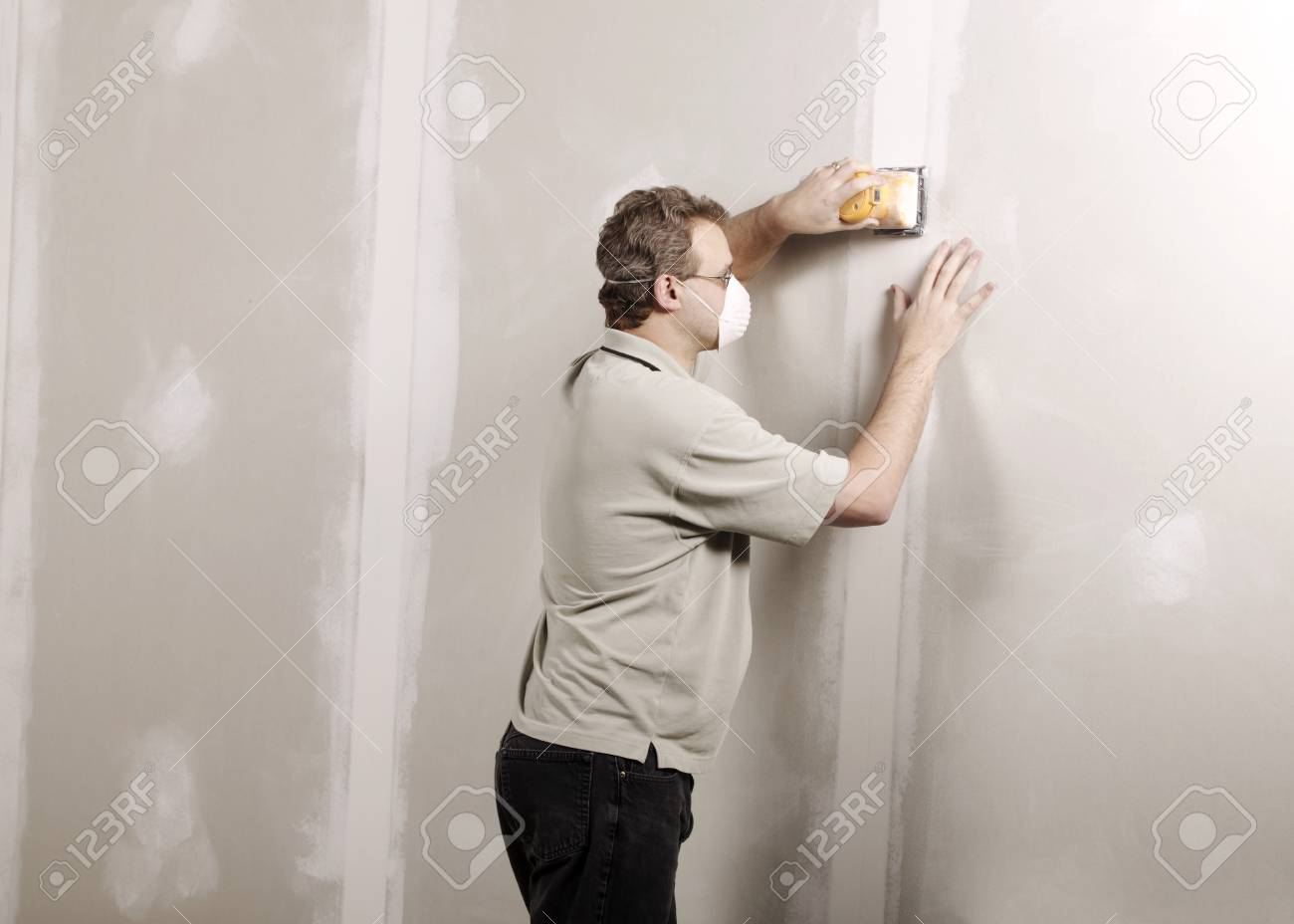 Man using a sander Stock Photo - 8241796