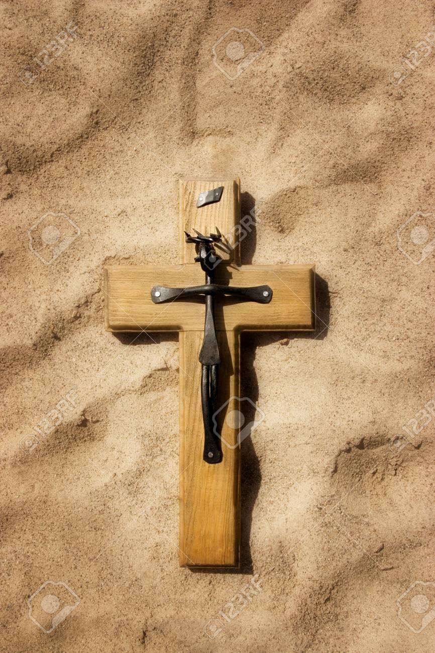 Christian cross on sand Stock Photo - 8243799