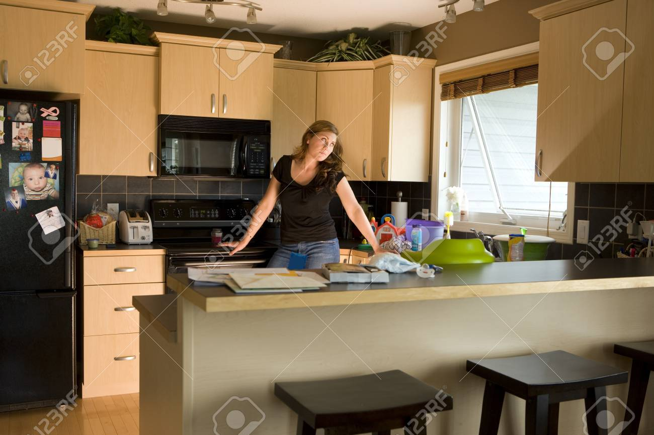 A woman in a kitchen Stock Photo - 8245437