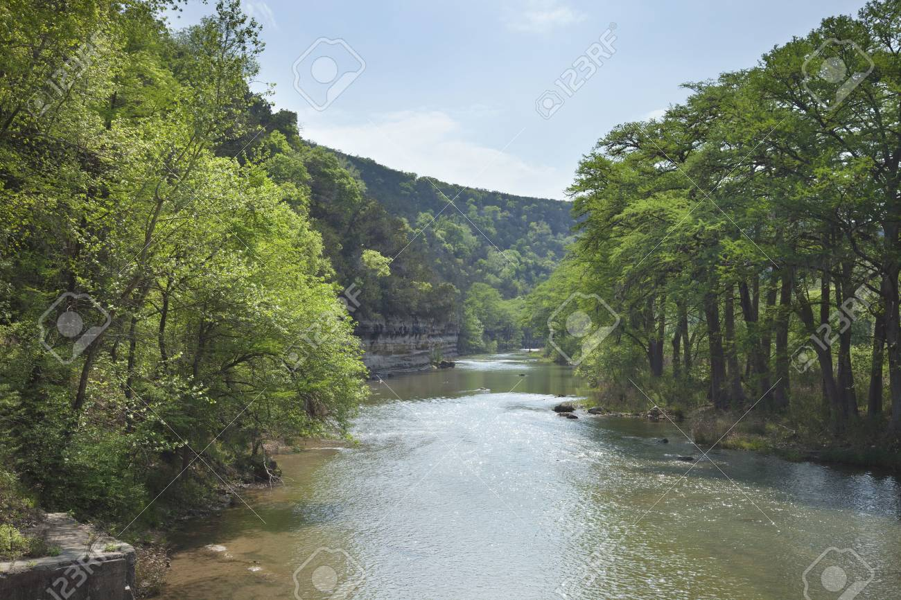 The Guadalupe River below cliffs of the Texas Hill Country during Spring - 50595762