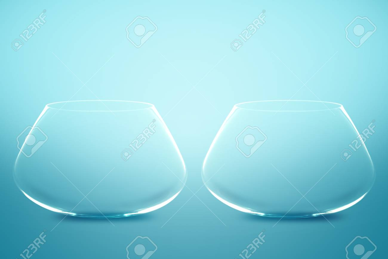 Empty Two fishbowls without water in front of blue background. Stock Photo - 11674739
