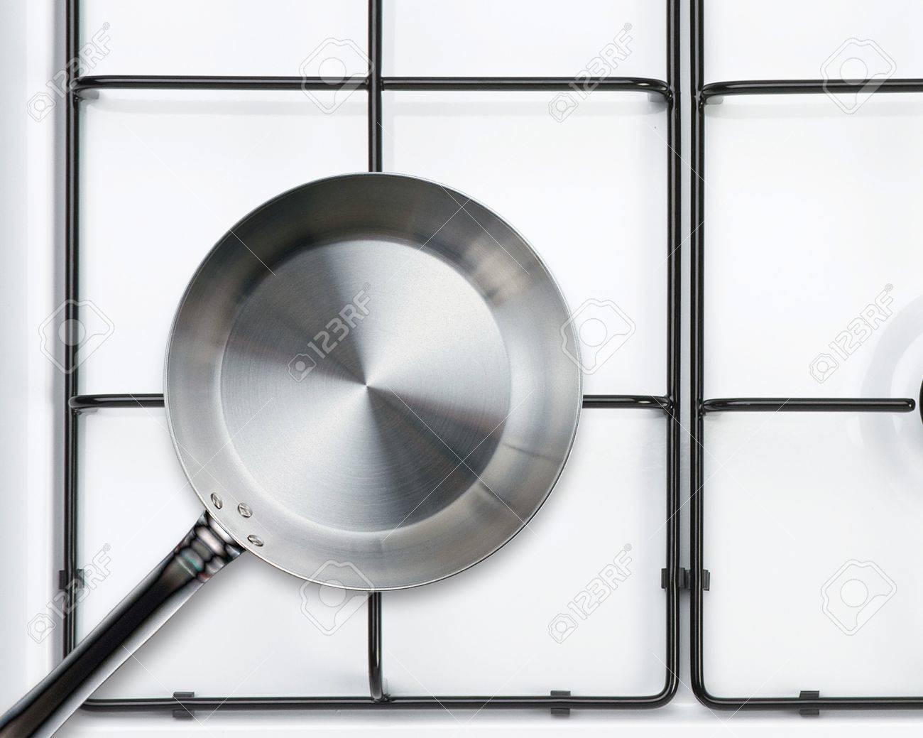 Empty steel frying pan on stove Stock Photo - 15551279