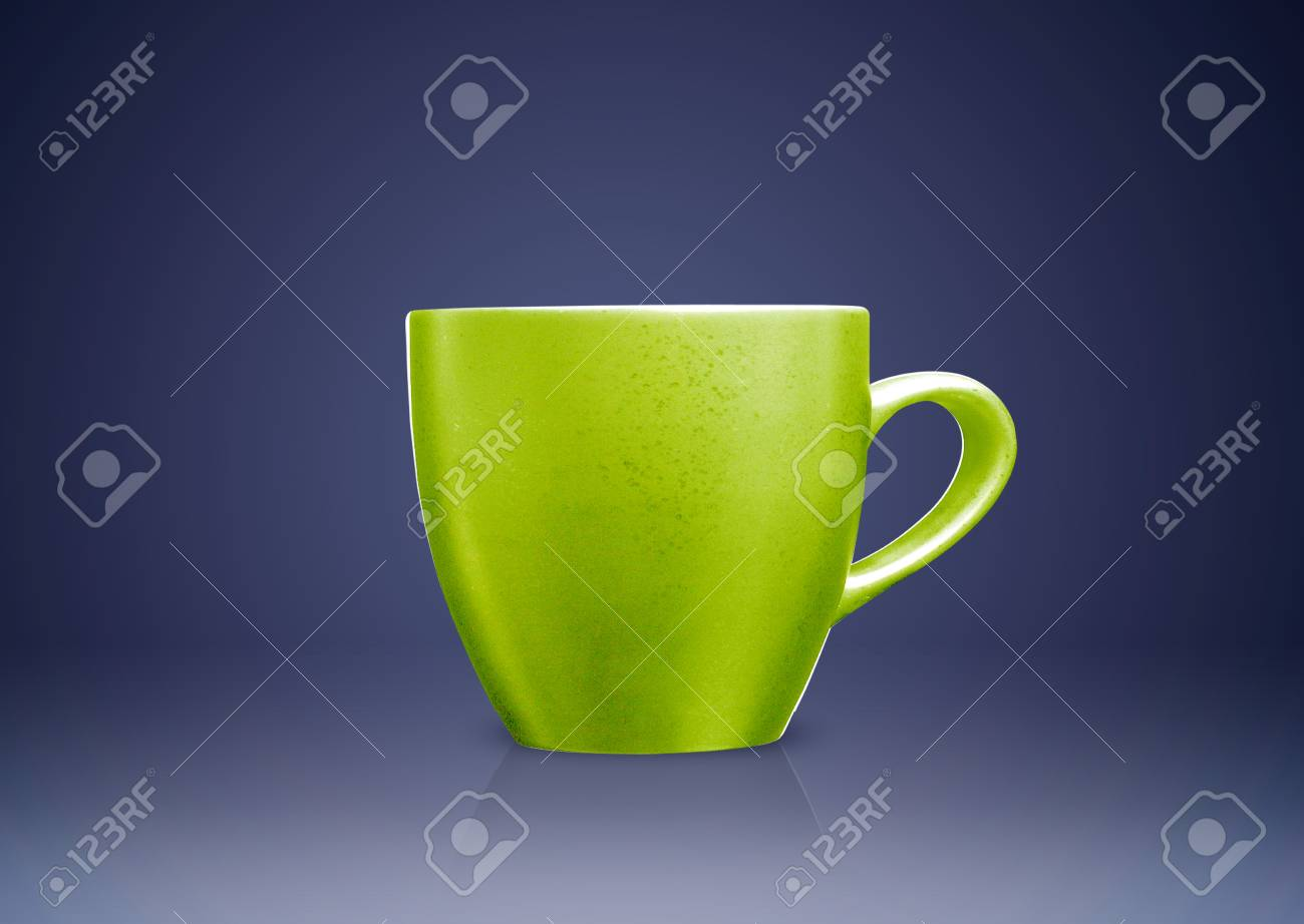 Green tea mug or cup on blue background. Stock Photo - 16822874