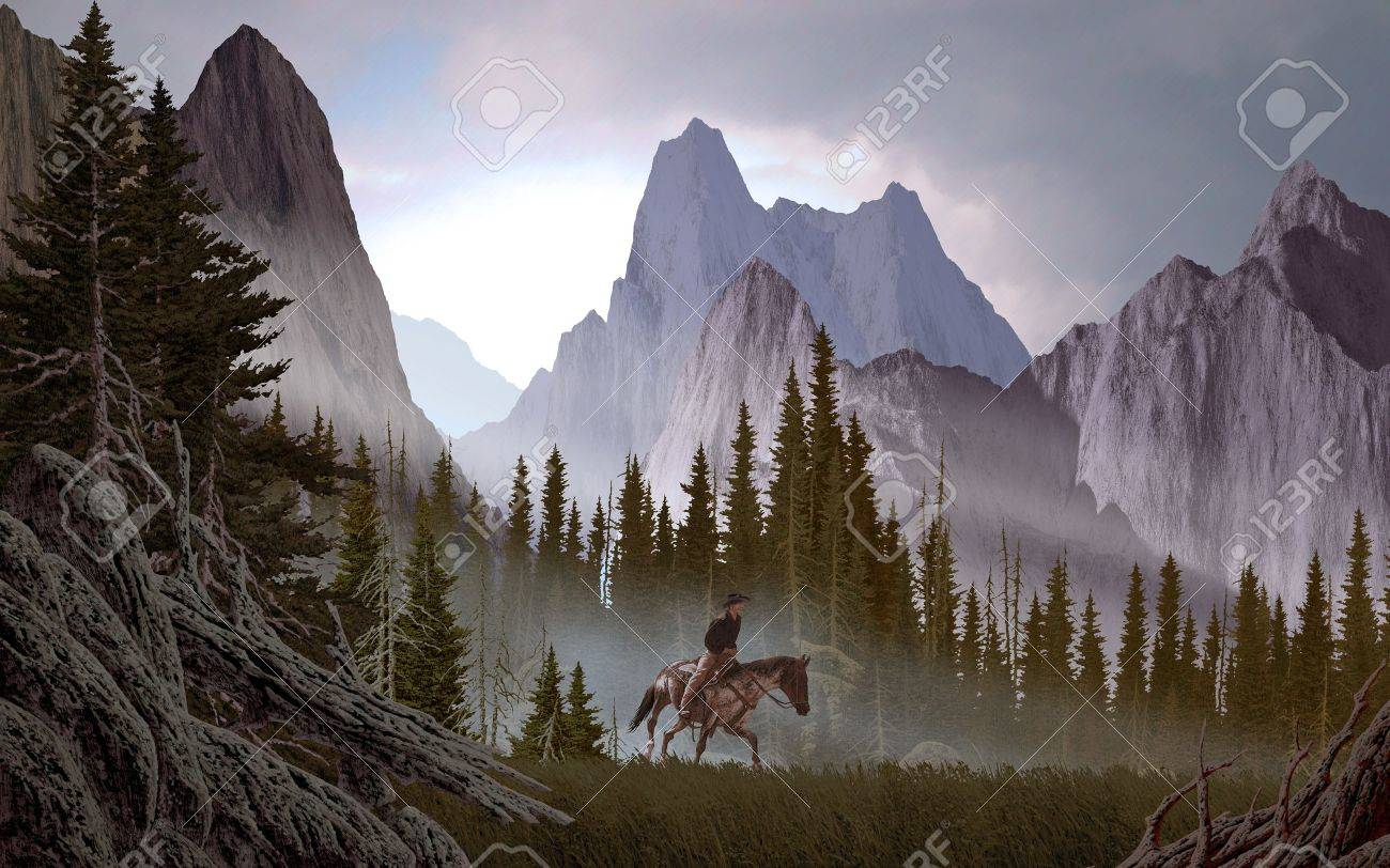 a rocky mountain landscape scene with cowboy stock photo picture