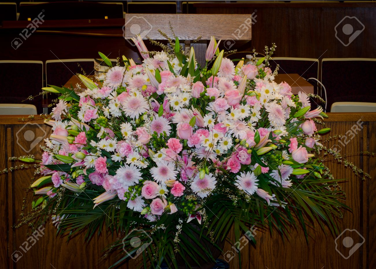 Spring pulpit flower arrangement with palm fronds and pink white spring pulpit flower arrangement with palm fronds and pink white and lavender carnations lillies mightylinksfo