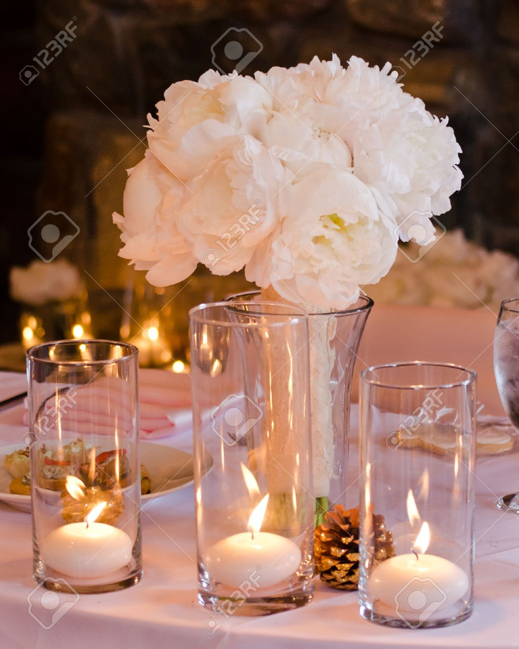 Pine Cone Candles White And Pink Peony Wedding Bouquet In A Vase Accented By Candles