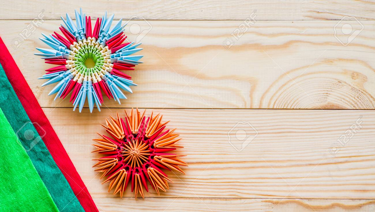 Module Origami Flowers With Paper On Wooden Background Stock Photo