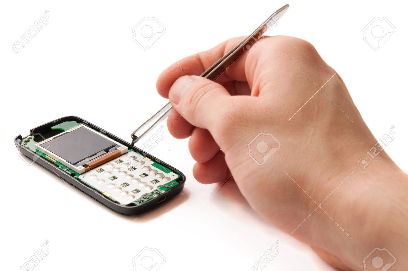 Mobile phone repair service with engineers hands working Stock Photo - 9851695