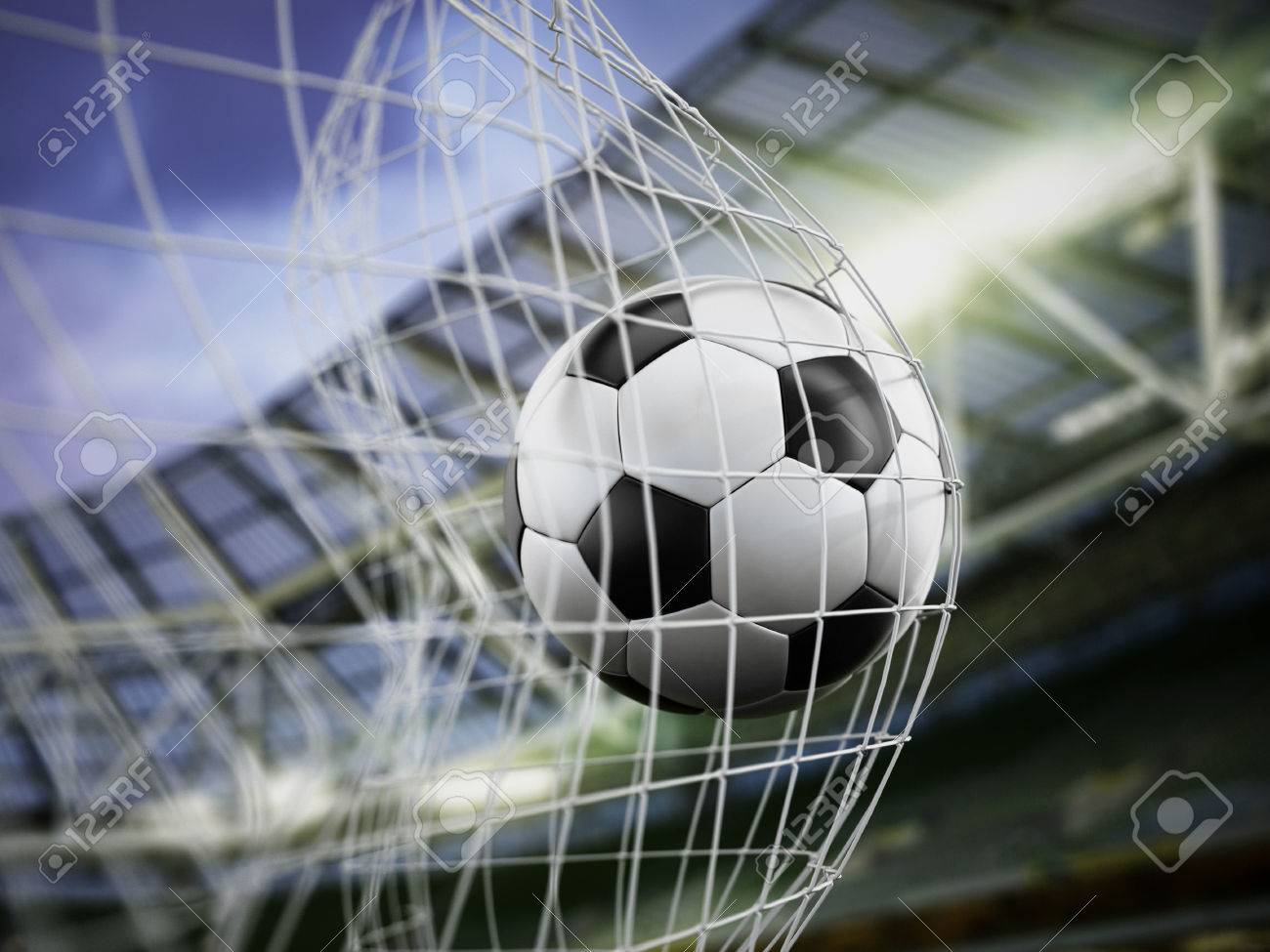 Football at the back of the net Stock Photo - 34982235