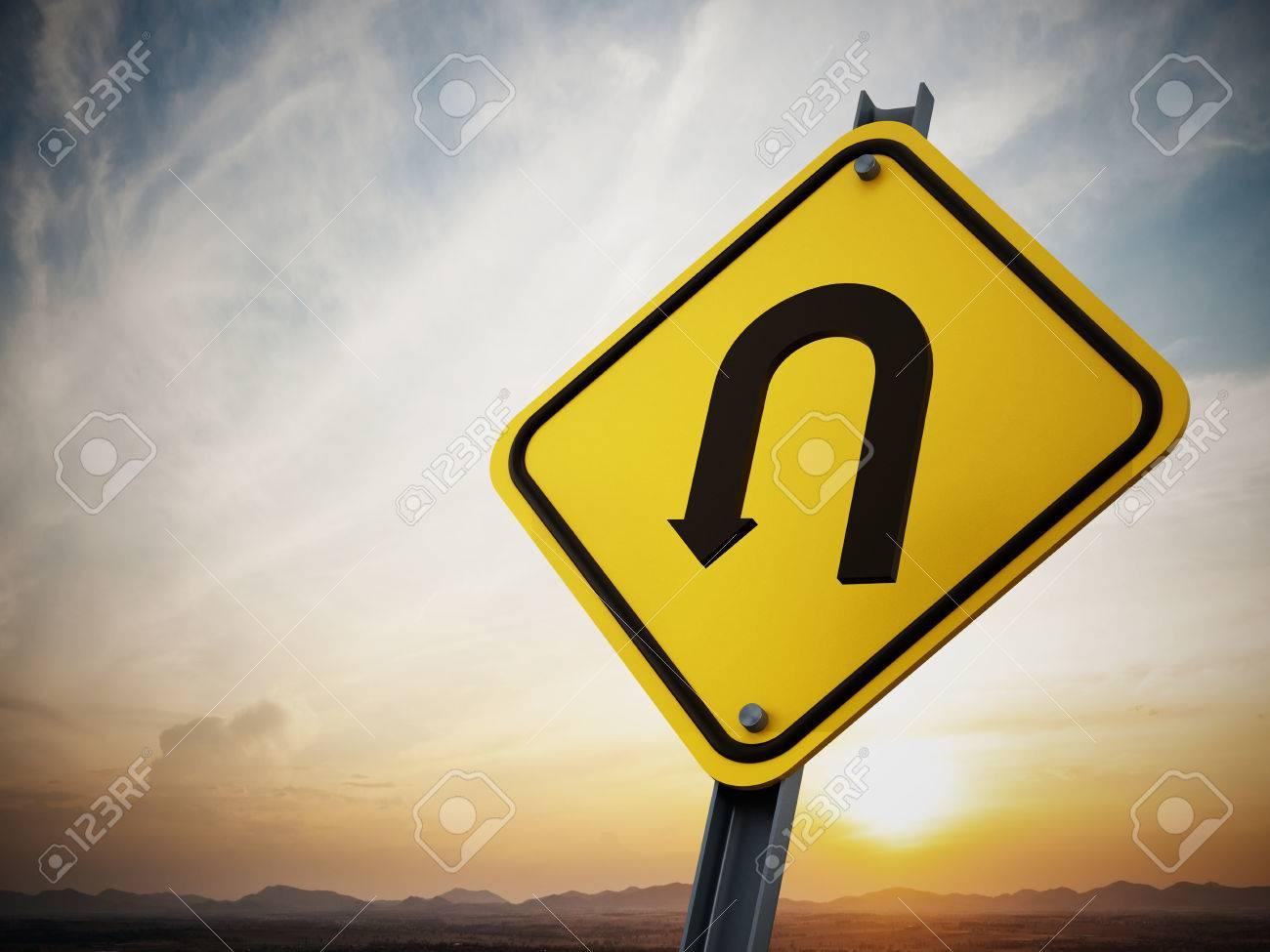 U turn road sign on setting sun background Stock Photo - 35371860