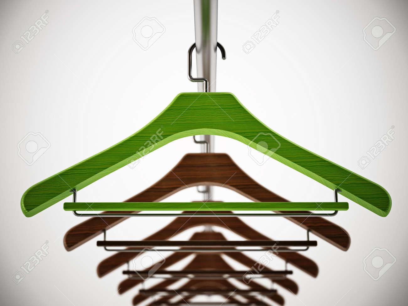 Green clothes-hanger stands out among regular hangers. 3D illustration. - 172256729