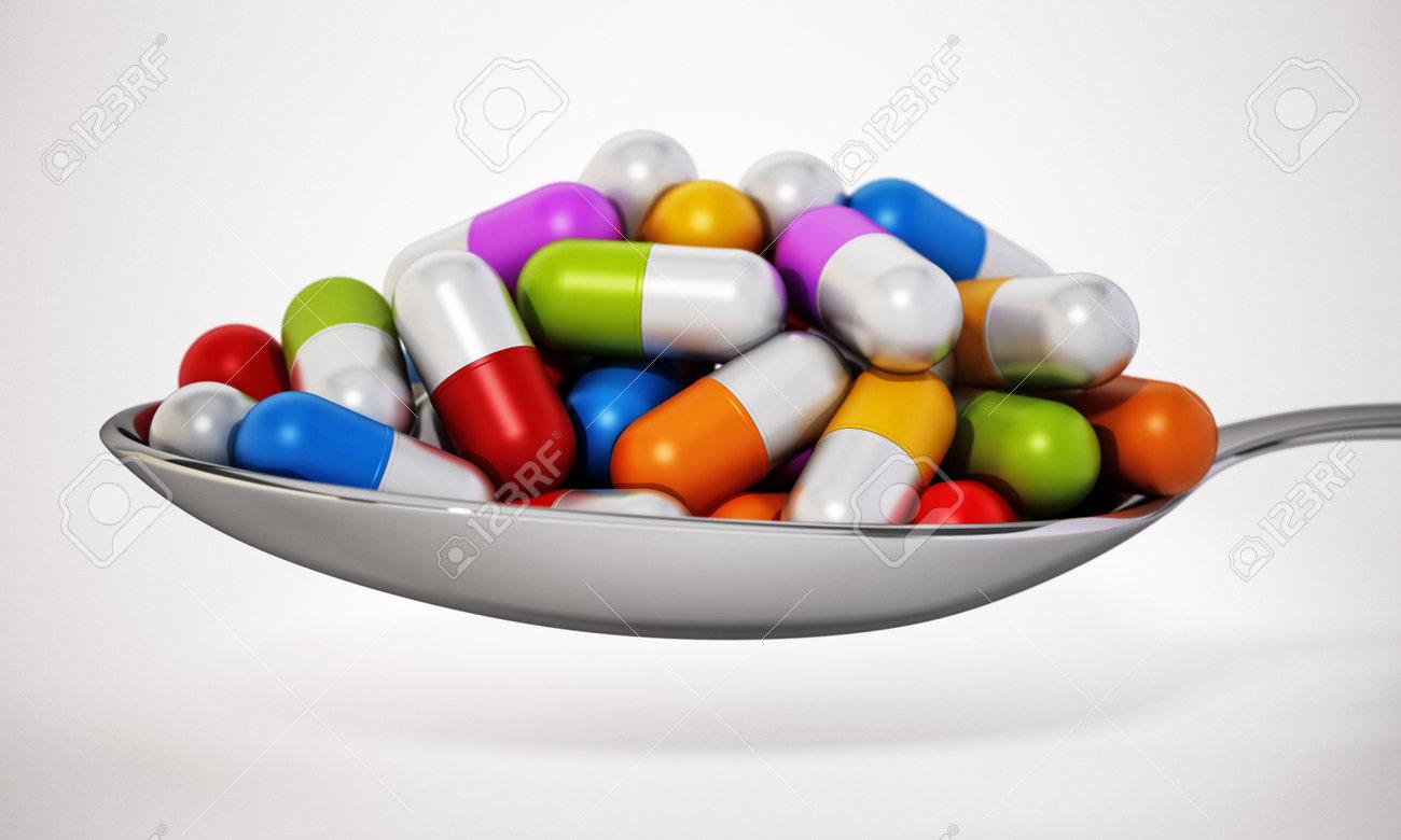 Multi colored vitamin pills inside a metal spoon. 3D illustration. - 173109664