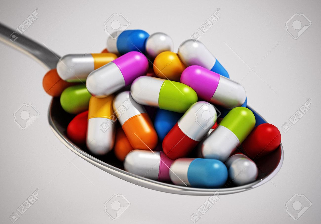 Multi colored vitamin pills inside a metal spoon. 3D illustration. - 173109665