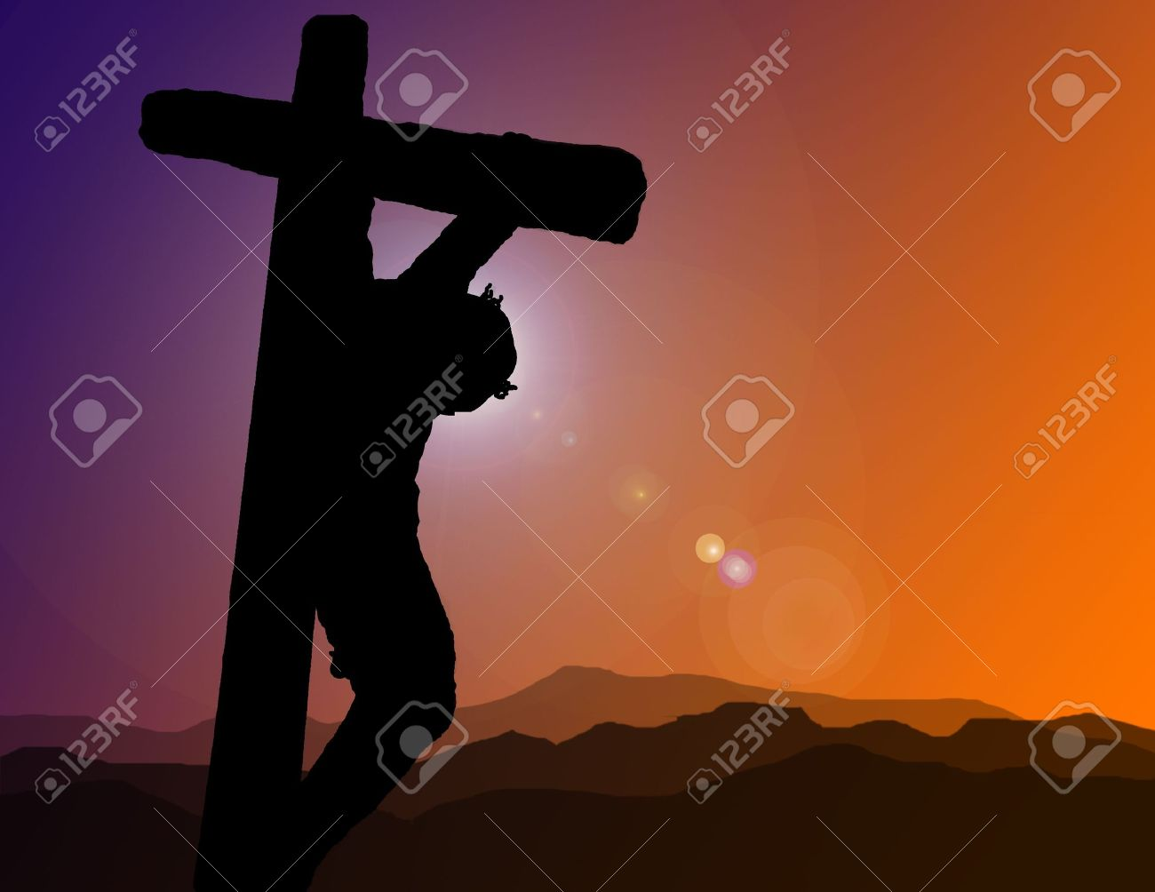 a silhouette of christ on the cross at calvary stock photo