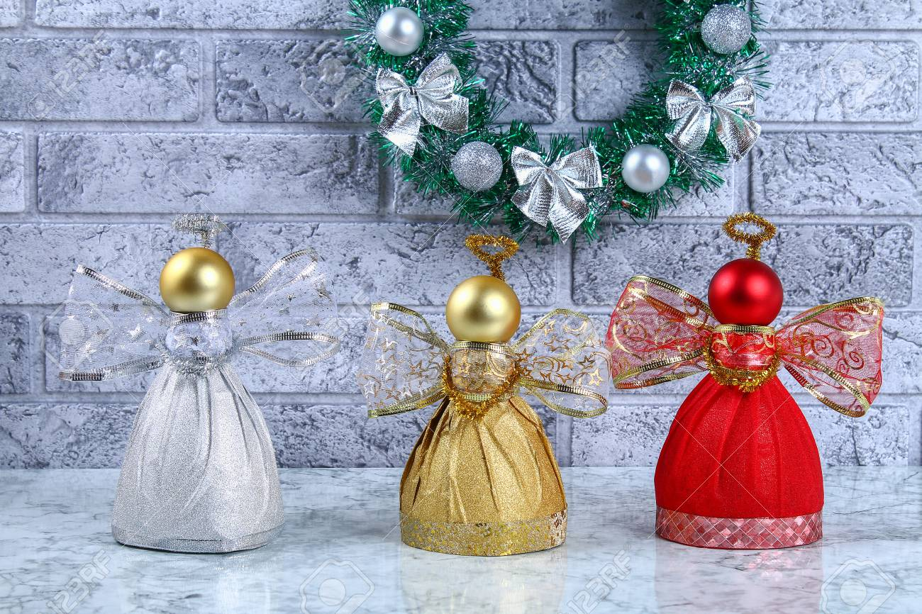 Diy Angel plastic bottle. Guide on the photo how to make a decorative angel from a bottle, self-adhesive shiny paper, ribbon and a Christmas ball with your own hands. Handmade. Step by step - 113199318