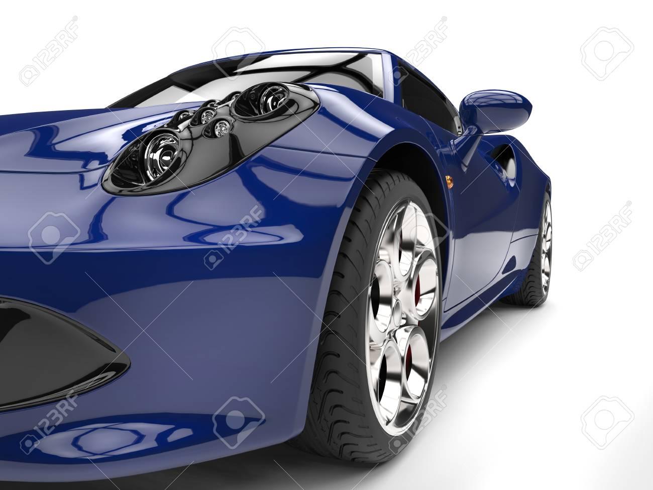 Royal blue sports car - headlight extreme closeup shot