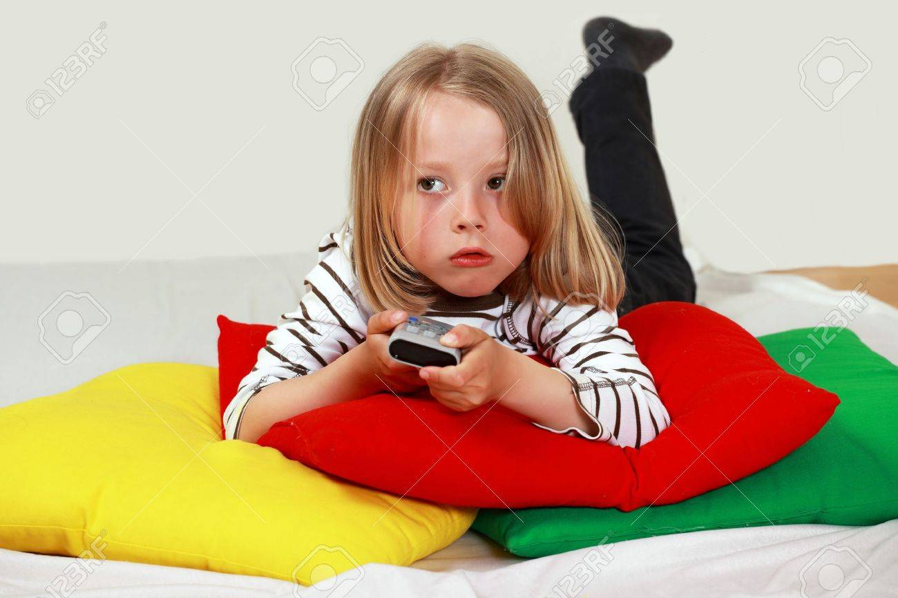 Cute child with TV remote changing channel Stock Photo - 9707044