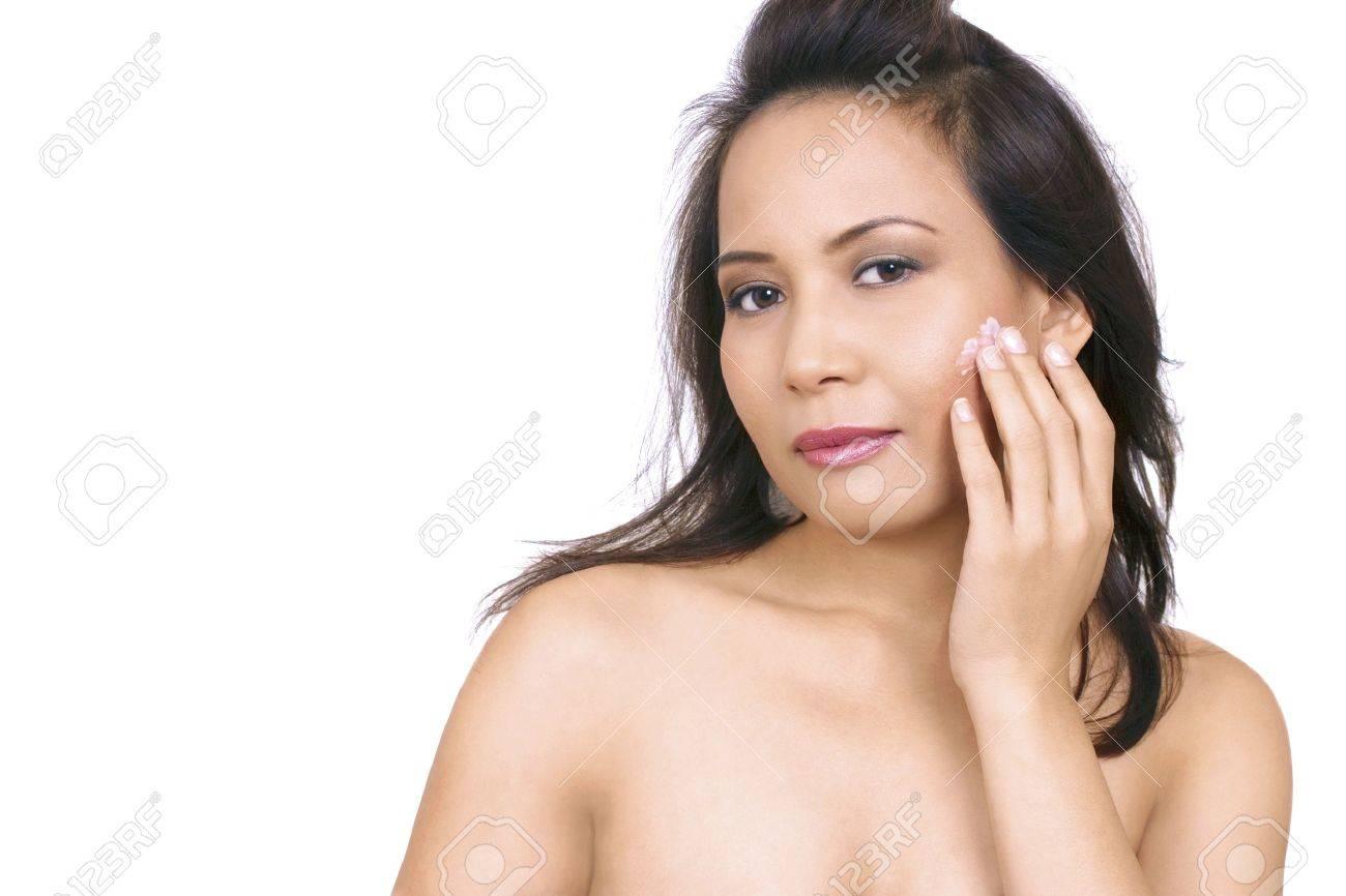 Beautiful asian woman applying face cream Stock Photo - 11597265