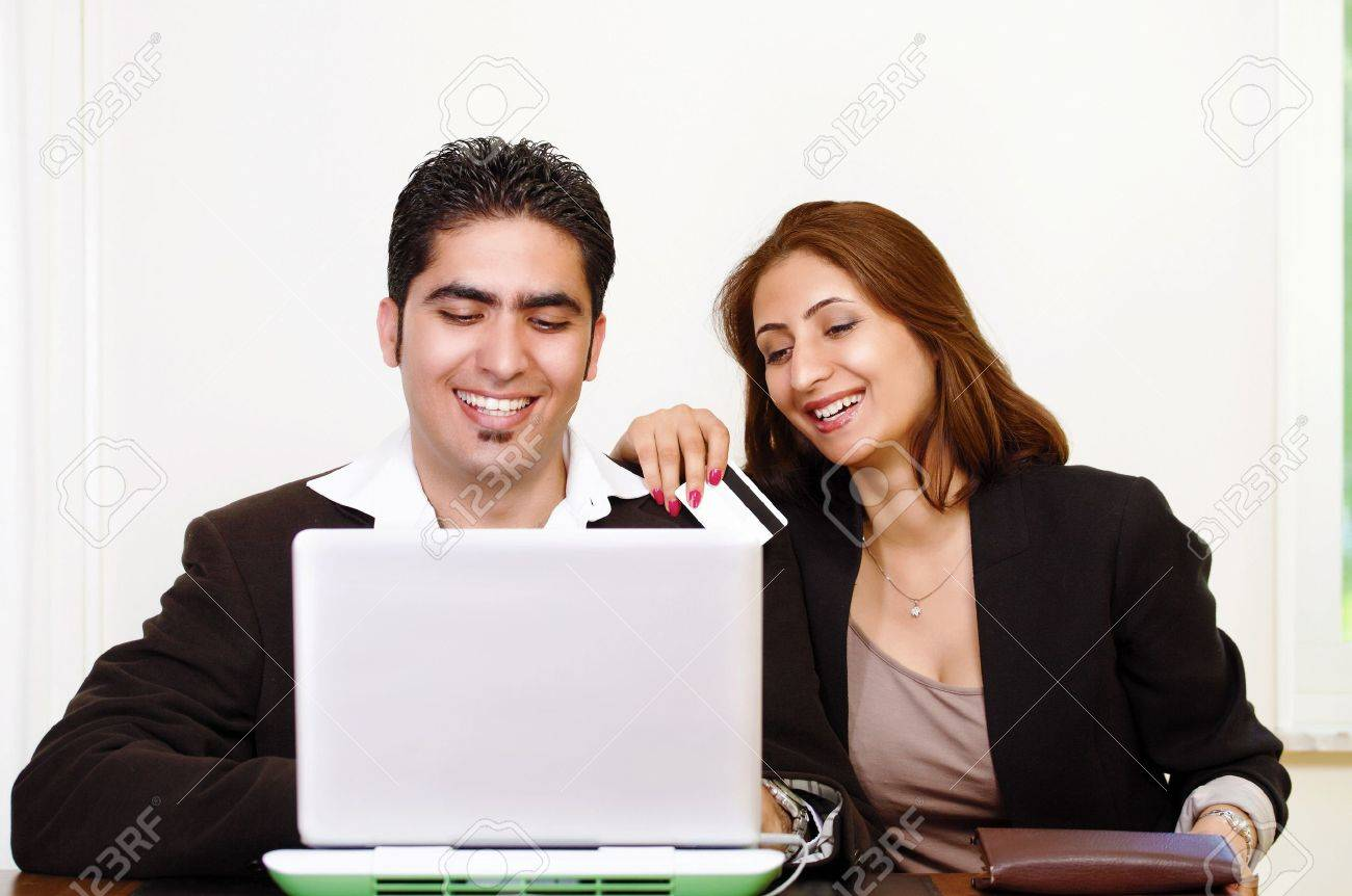 Happy couple shopping online with credit card Stock Photo - 14508426