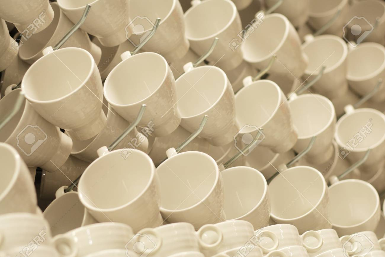 Porcelain cups on a display rack Stock Photo - 16312116