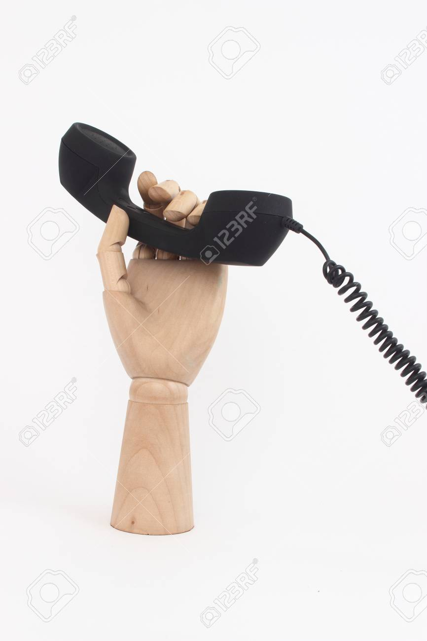 wooden hand with wired telephone isolated Stock Photo - 19444337