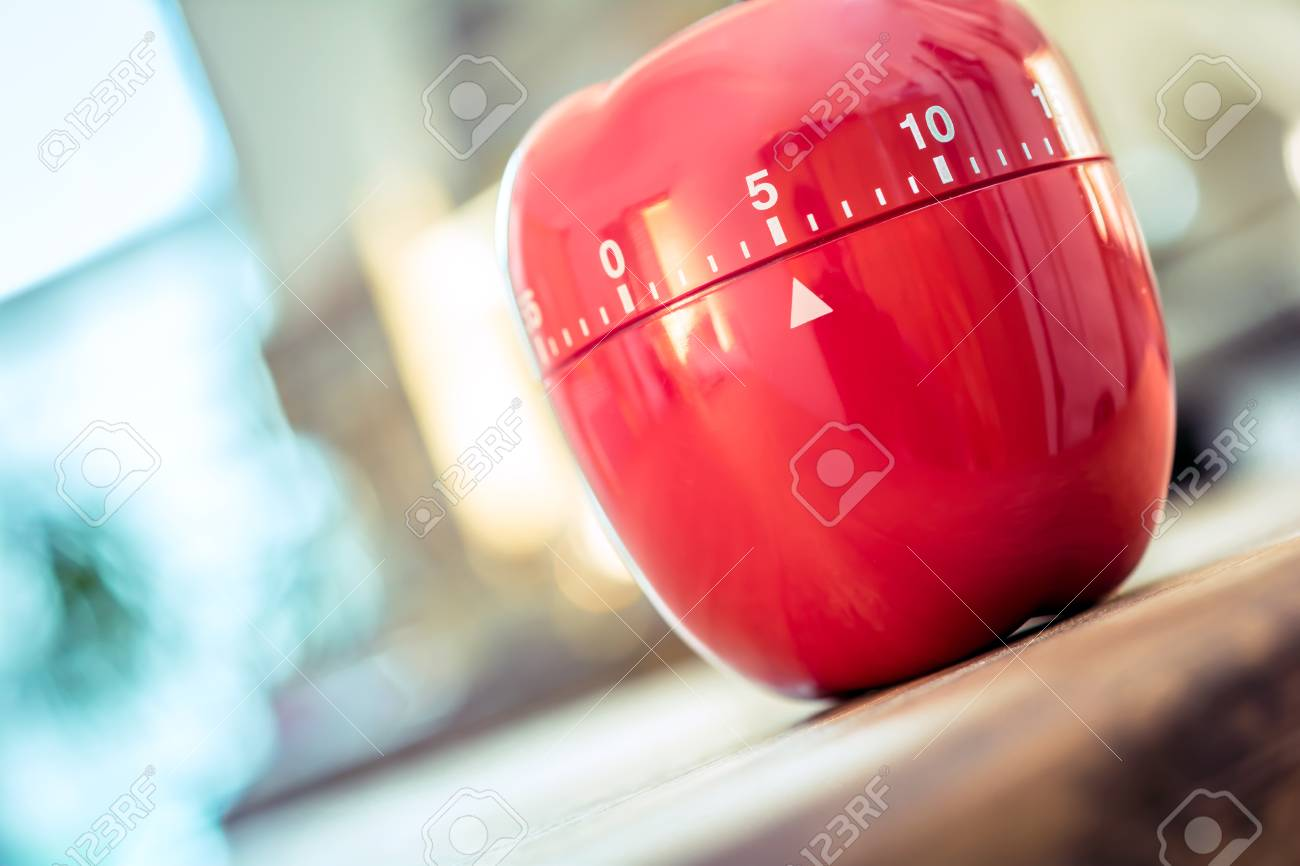 5 Minutes - Red Kitchen Egg Timer In Apple Shape On A Table