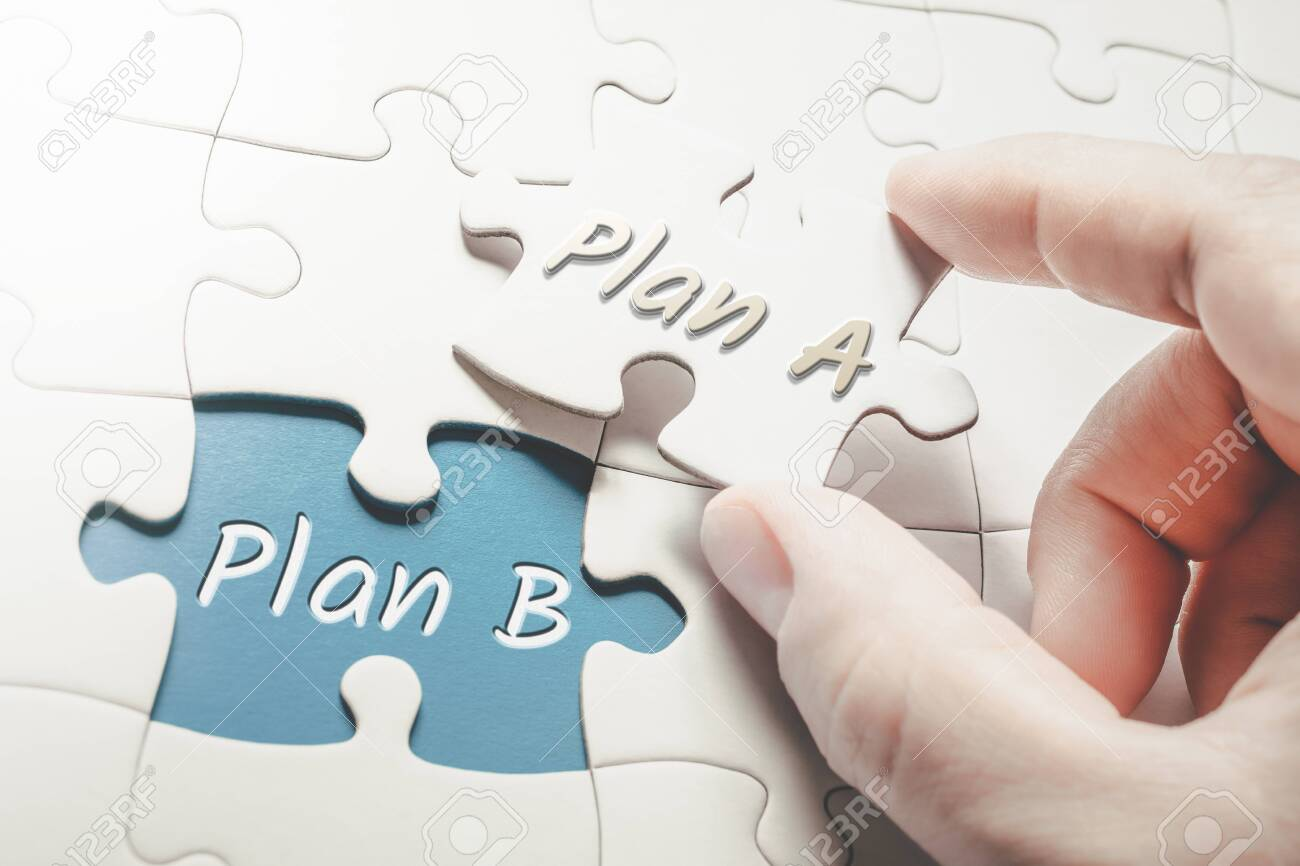 Plan A and Plan B In Missing Piece Jigsaw Puzzle, Two Fingers Holding Plan A Piece - 141008719