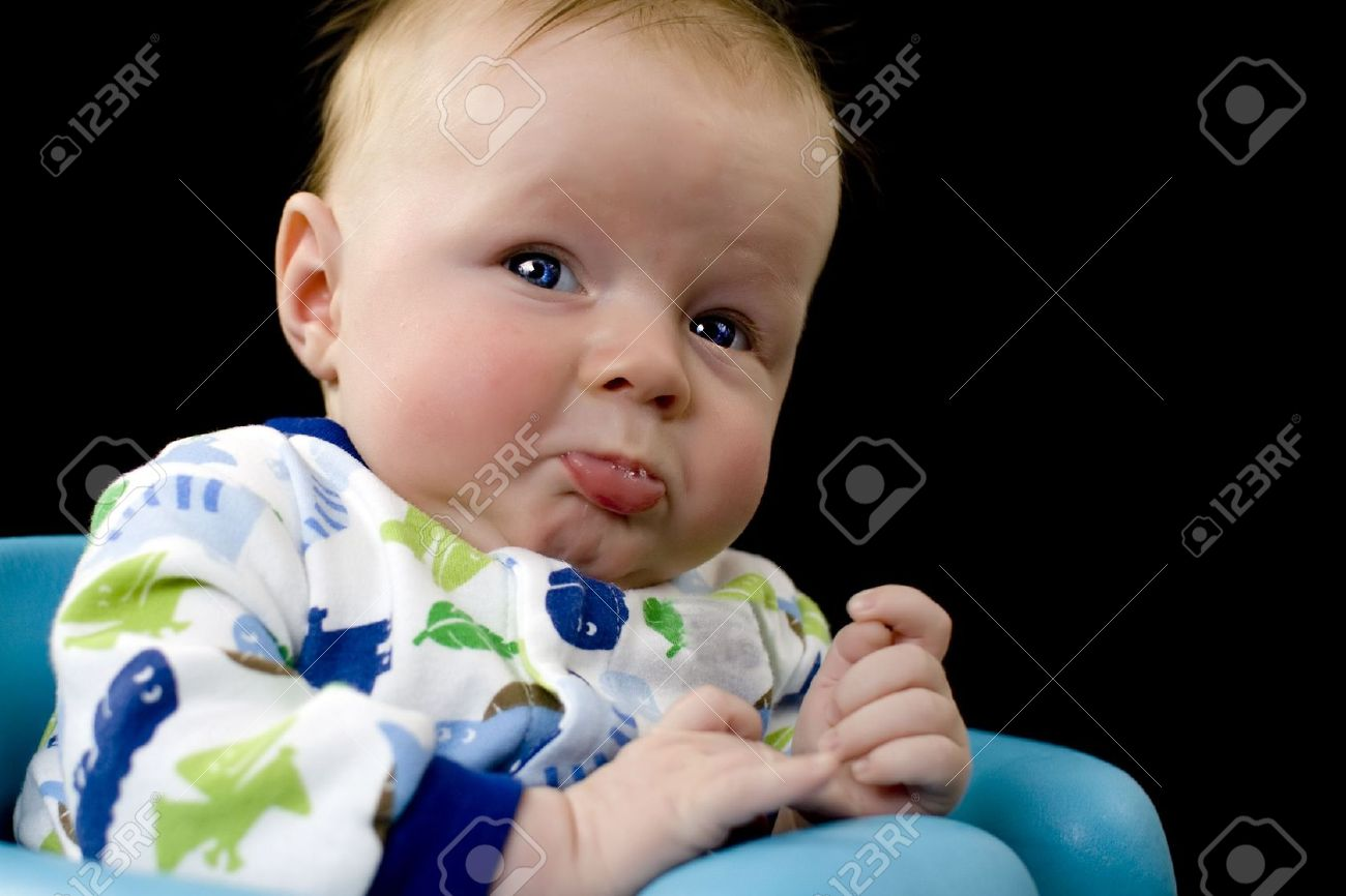 Baby boy about to cry with lower lip sticking out and pouting Stock Photo - 4874594