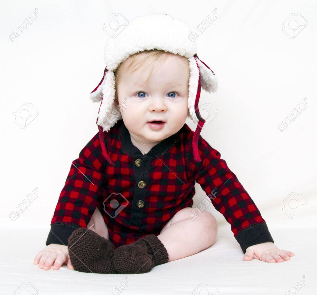 3f40b71b6 Happy Christmas baby with red plaid shirt, furry, fleece plaid hat with  brown boats