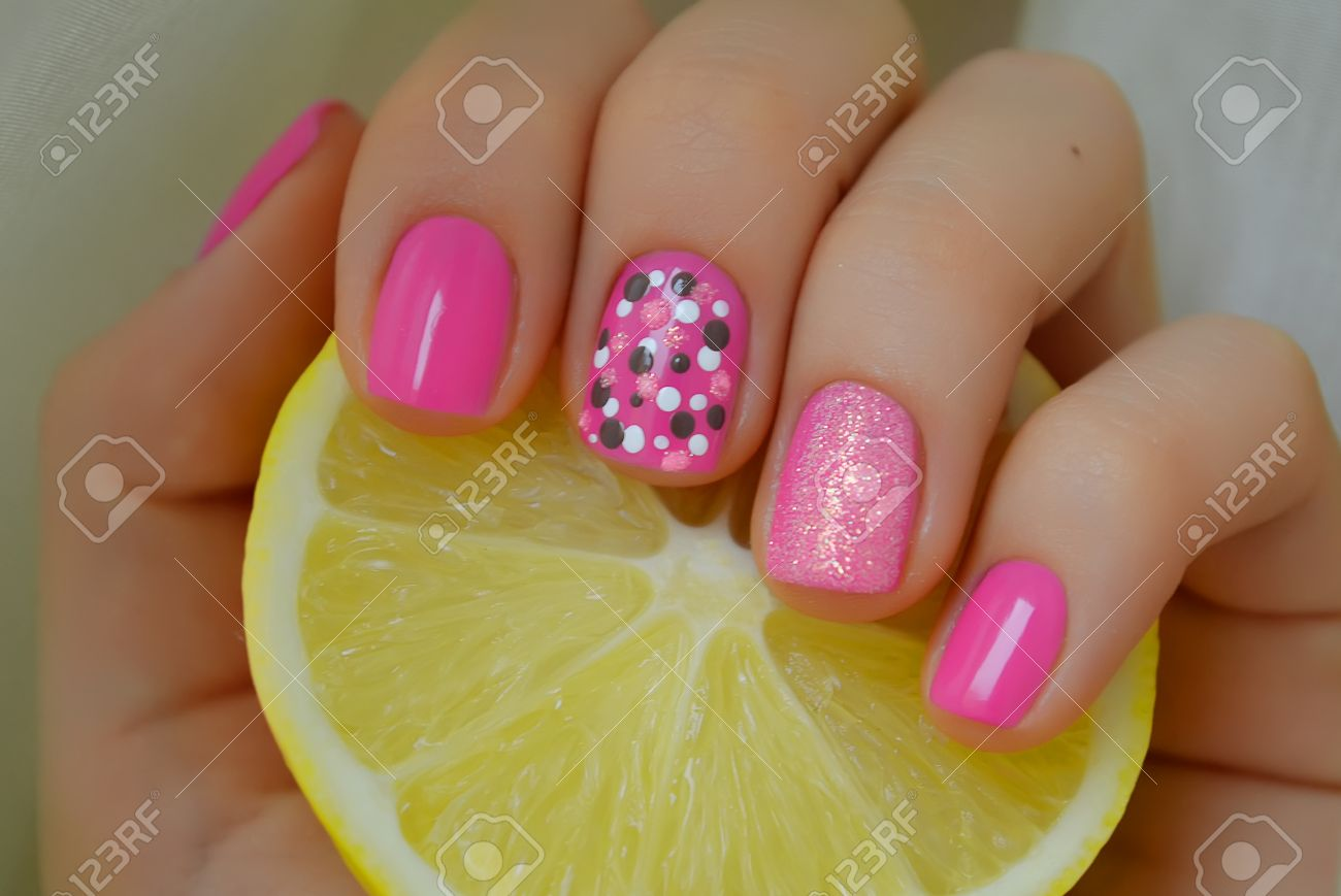 Nict Pink Nail Art With Grey And White Dots Photo With Lemon Stock