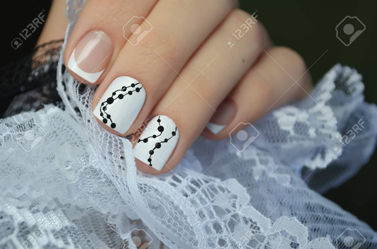 Beautiful White Nail Art Design French Manicure Stock Photo