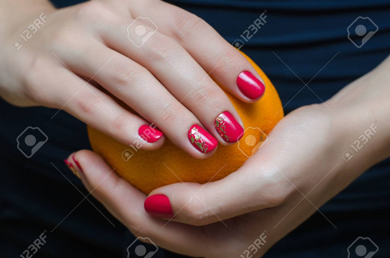 Female Hand With Dark Pink Nail Design. Stock Photo, Picture And ...