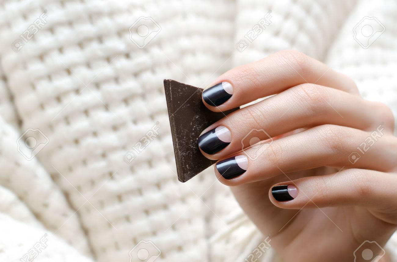 Female Hands With Dark Brown Nail Design Holding Chocolate Stock ...