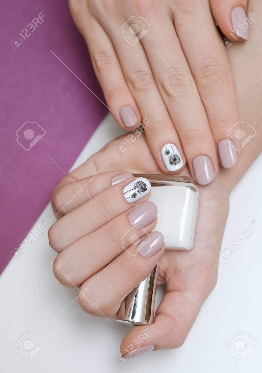 Beautiful Female Hand With Dandelion Nail Design Holding Nail ...