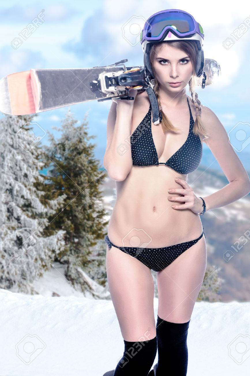 freeride naked girl with snow landscape at background stock photo