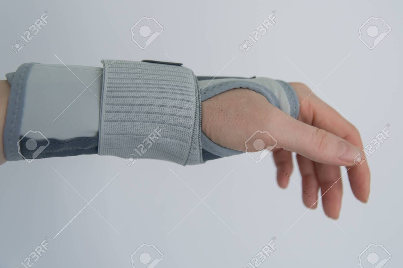 Female hand with orthosis, recovery and treatment with modern orthosis. - 143951798
