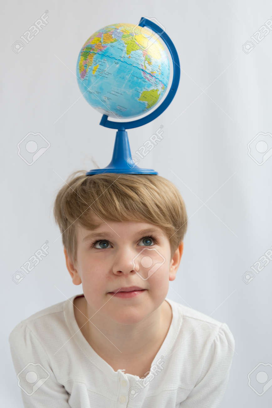 The child is holding a globe on his head in balance. The concept of the dependence of the earth on the future generation - 167431551