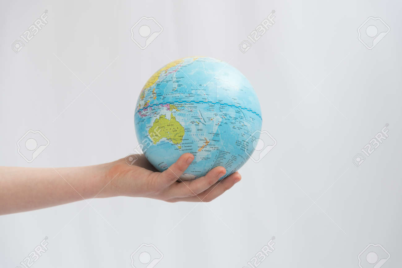Childrens hands carefully hold the globe. Concept. Our land is in the hands of the future generation - 167359879