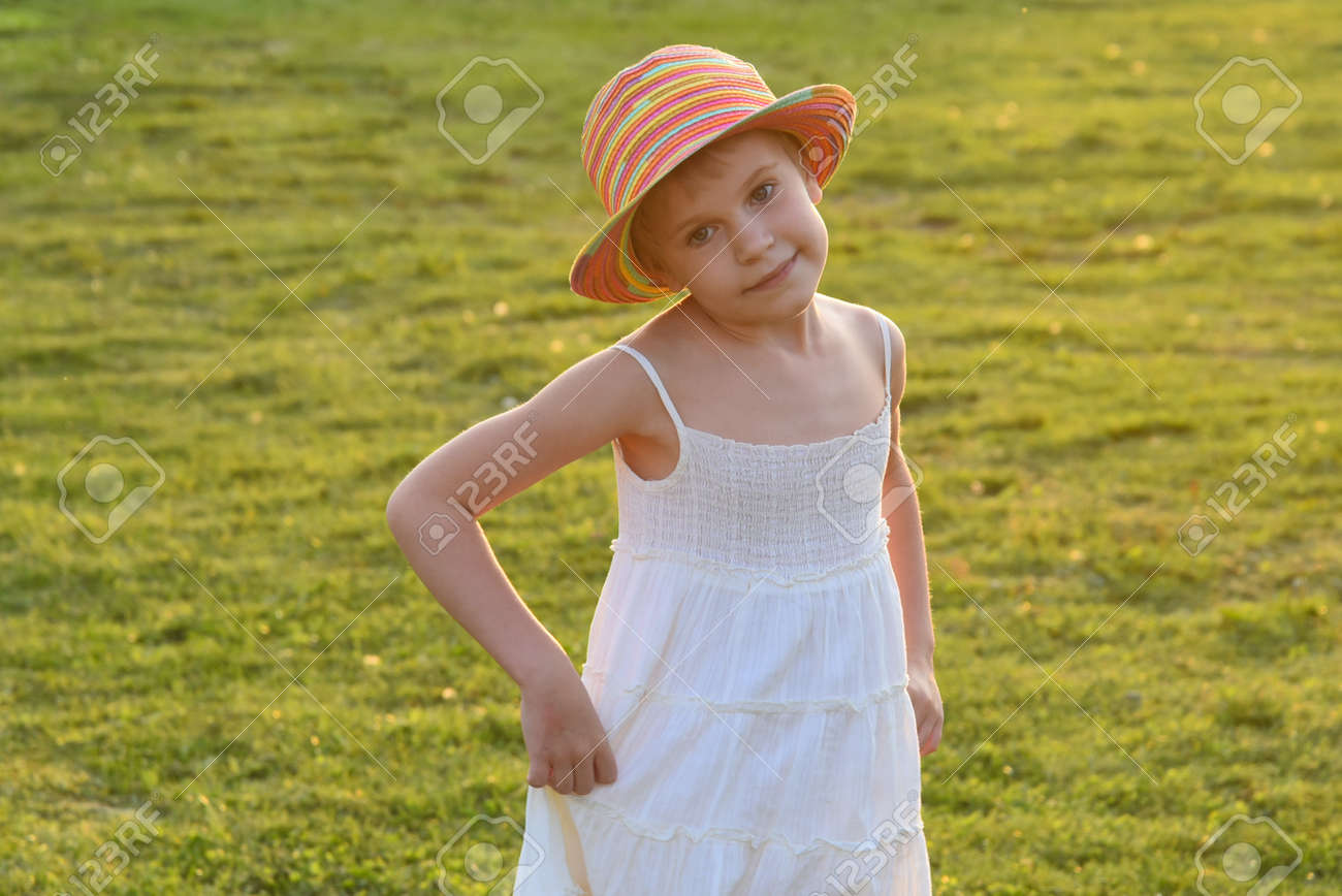 little girl dances and whirls in the sun. Carelessness and happiness - 167350281