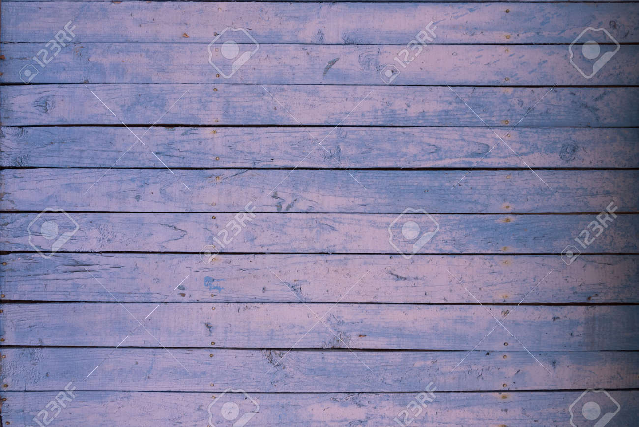 Boards of delicate blue and pink shades. The texture of a wooden fence. Background, texture - 168593724
