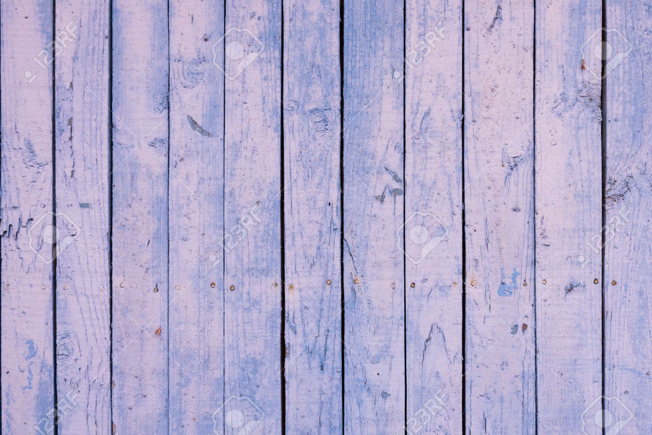 Boards of delicate blue and pink shades. The texture of a wooden fence. Background, texture - 168593738