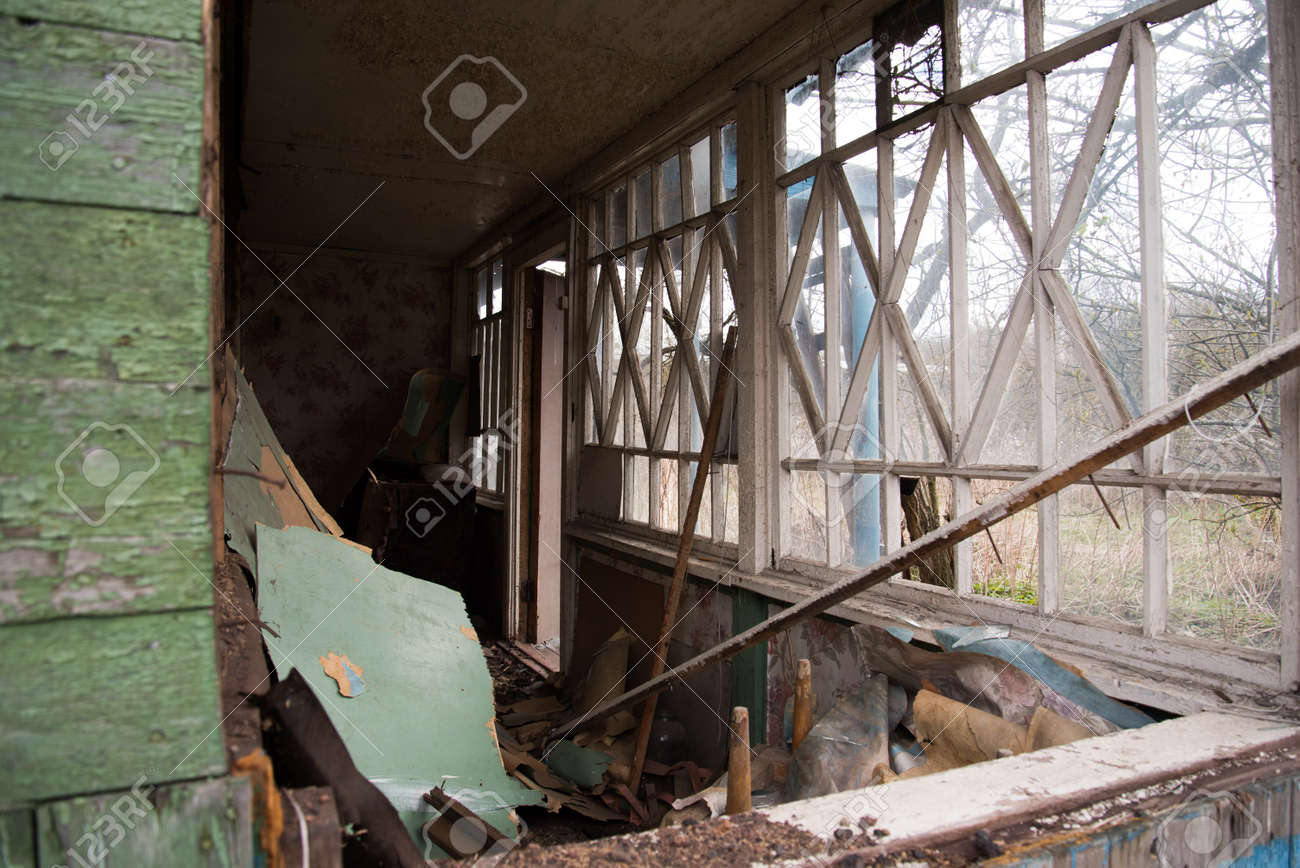 An old abandoned house with broken windows. Destruction concept. Broken glass and mess - 168593807