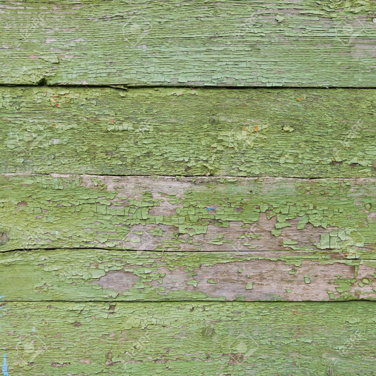 Old boards, background texture. Green paint. horizontal boards with old paint - 168593893