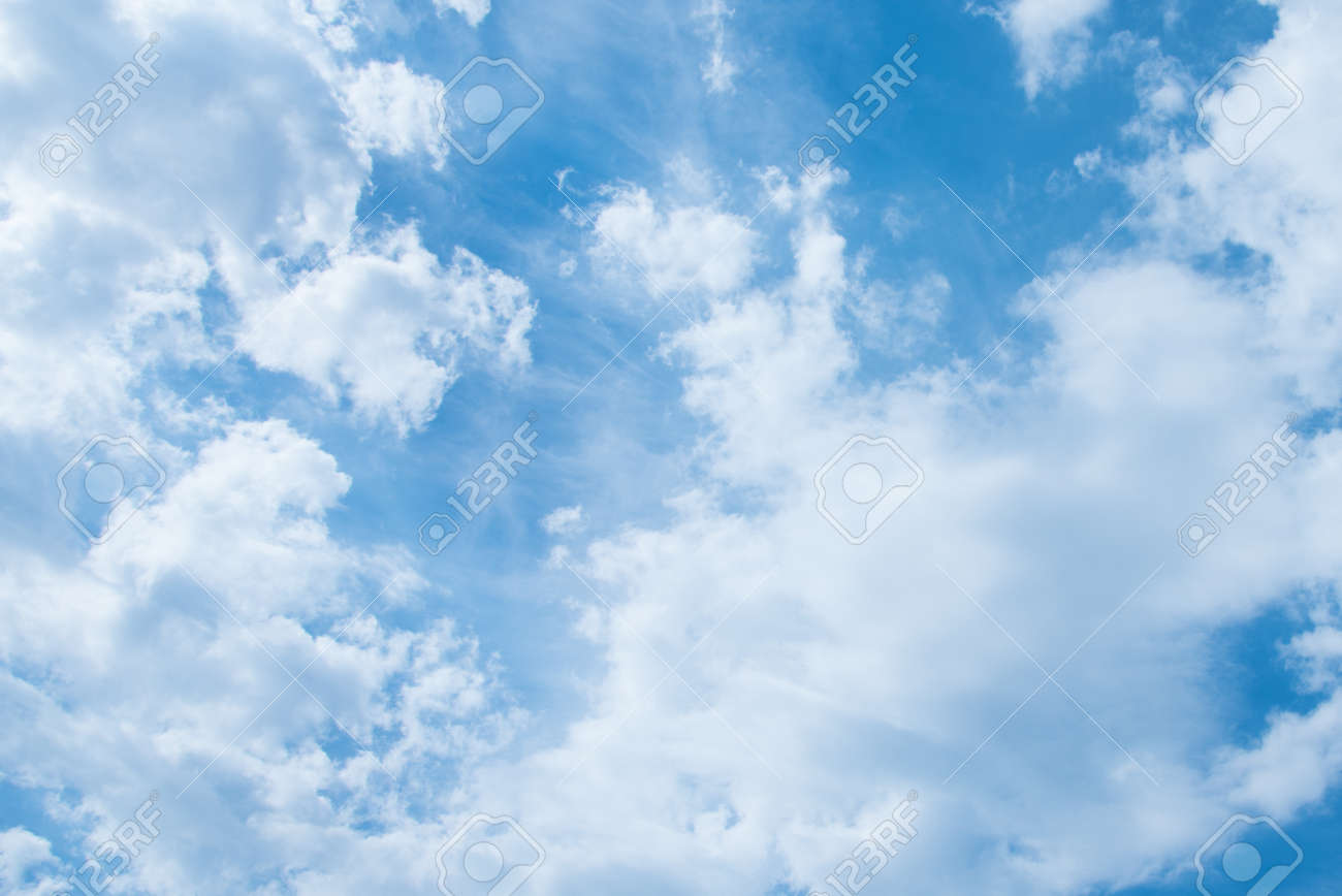 Blue sky and white clouds. Clouds texture. Nice sunny sky. A positive picture - 168593944