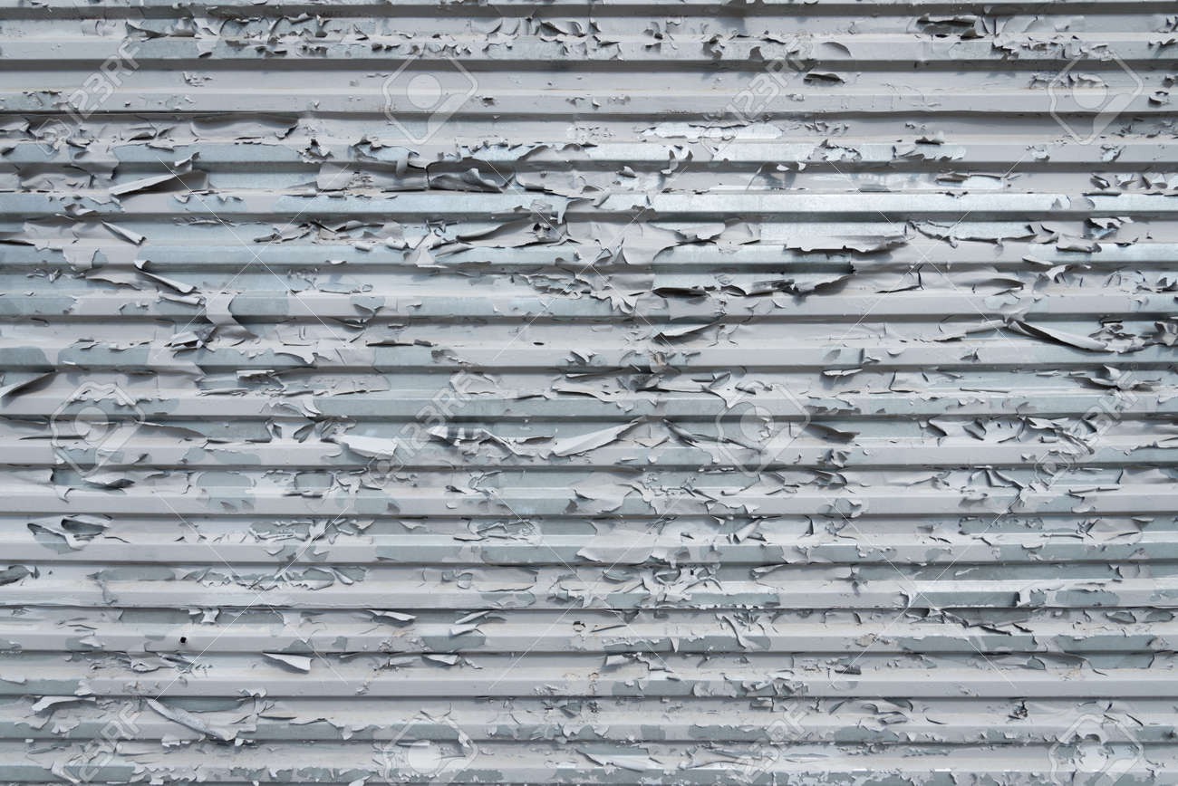 The texture of peeling old paint. Corrugated iron sheet. Background, texture. The concept of dry skin. The concept of aging - 170118829