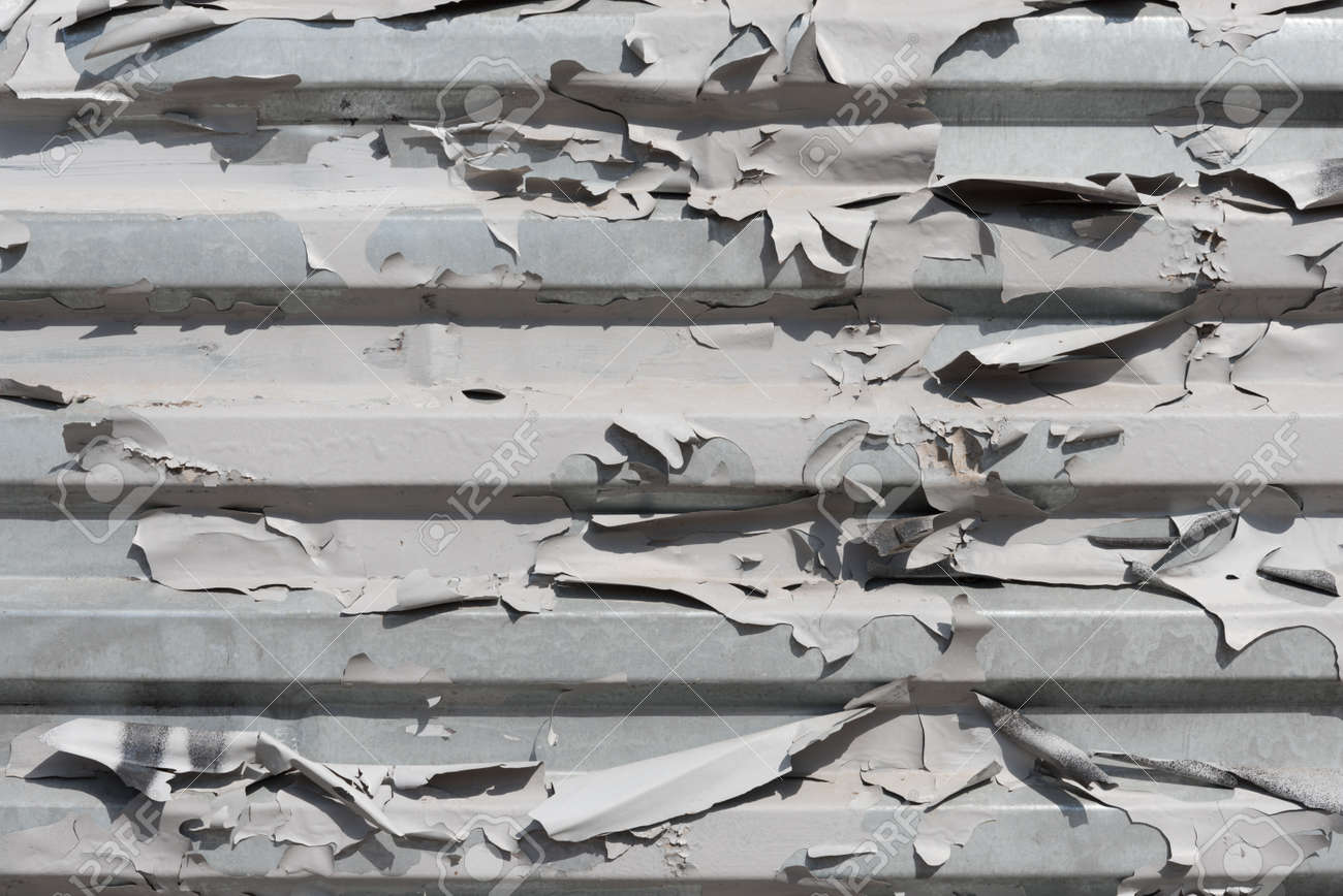 The texture of peeling old paint. Corrugated iron sheet. Background, texture. The concept of dry skin. The concept of aging - 170095440