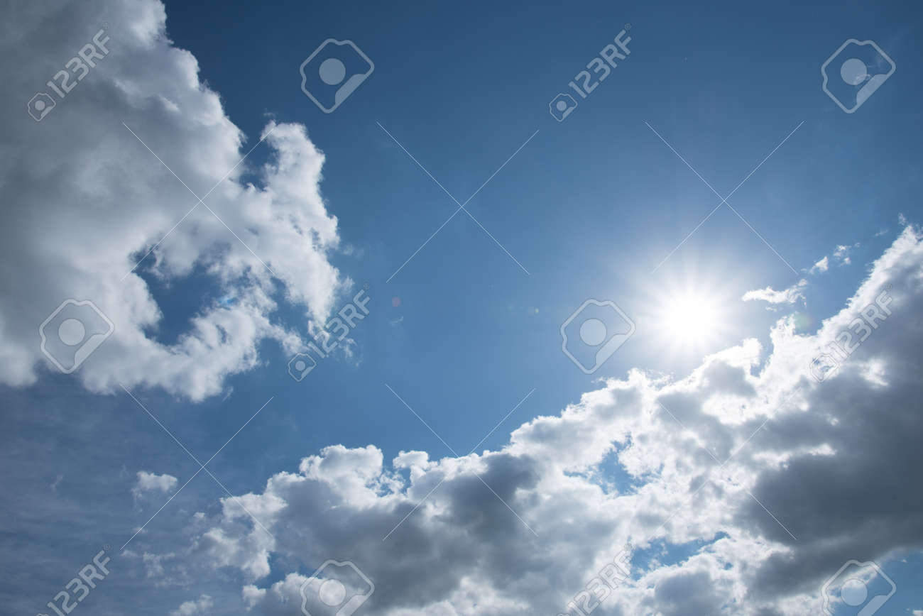 Blue sky, white clouds and sun. Background, texture. - 170095468