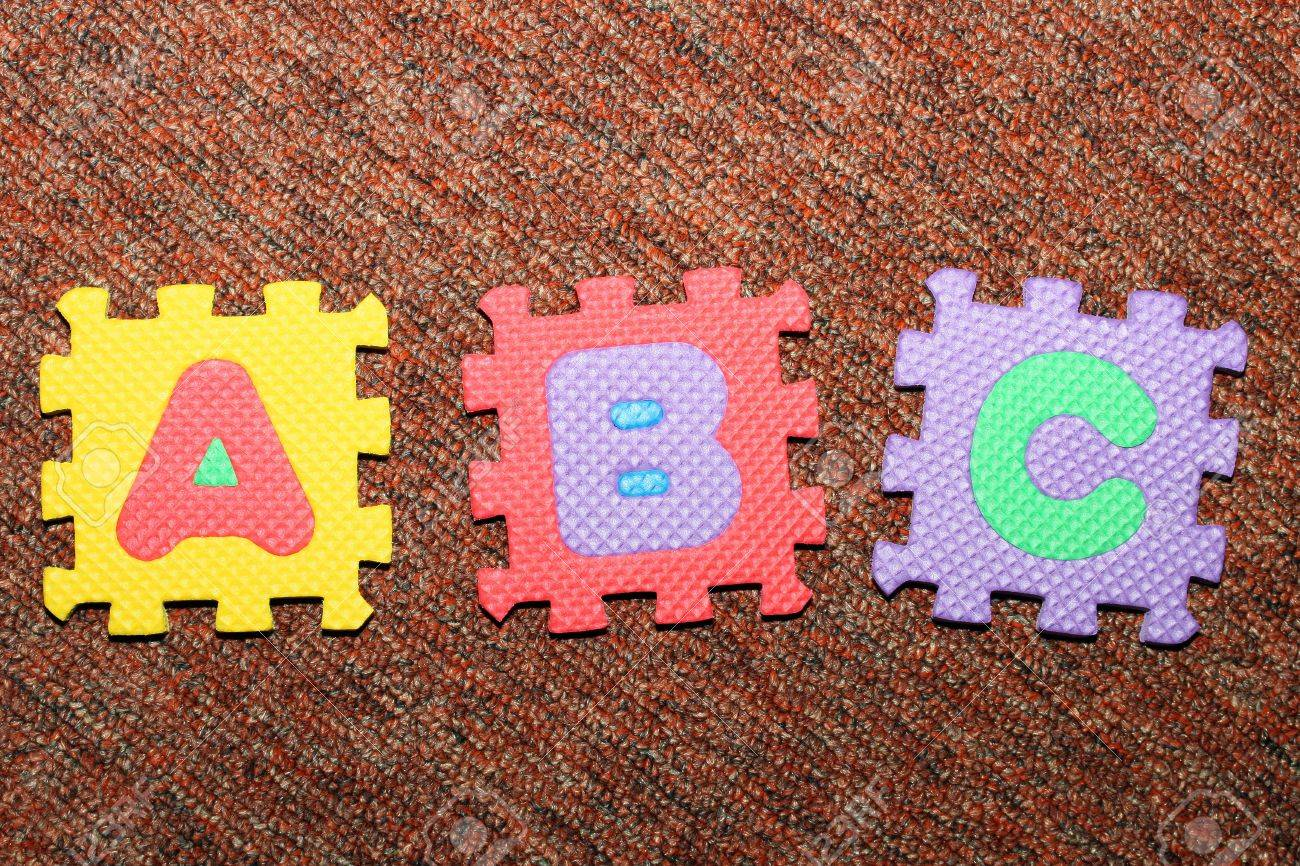carpet letters. letters a, b, c, on the carpet, from colorful letter-puzzle carpet a