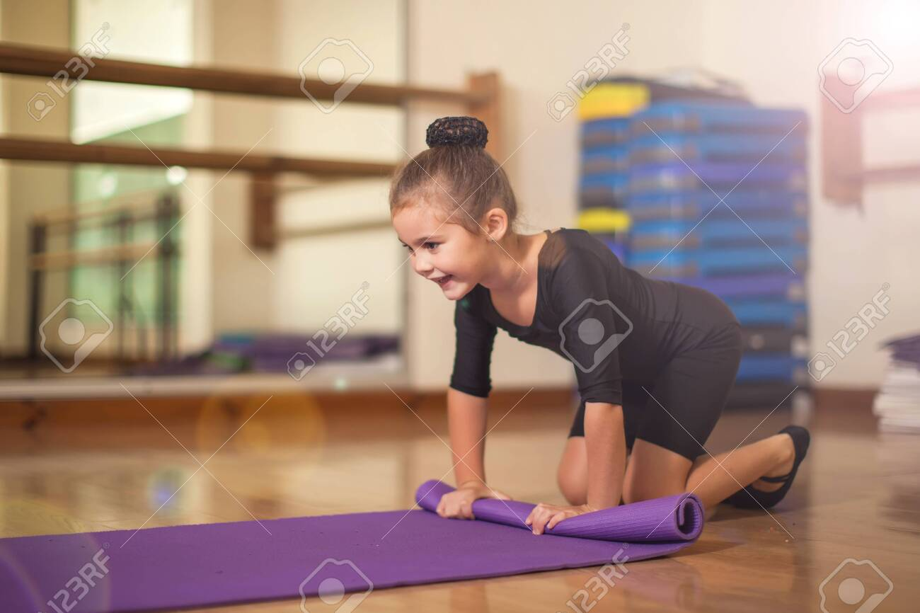 Kid girl at gymnastic class doing exercises. Children and sport concept - 154753925