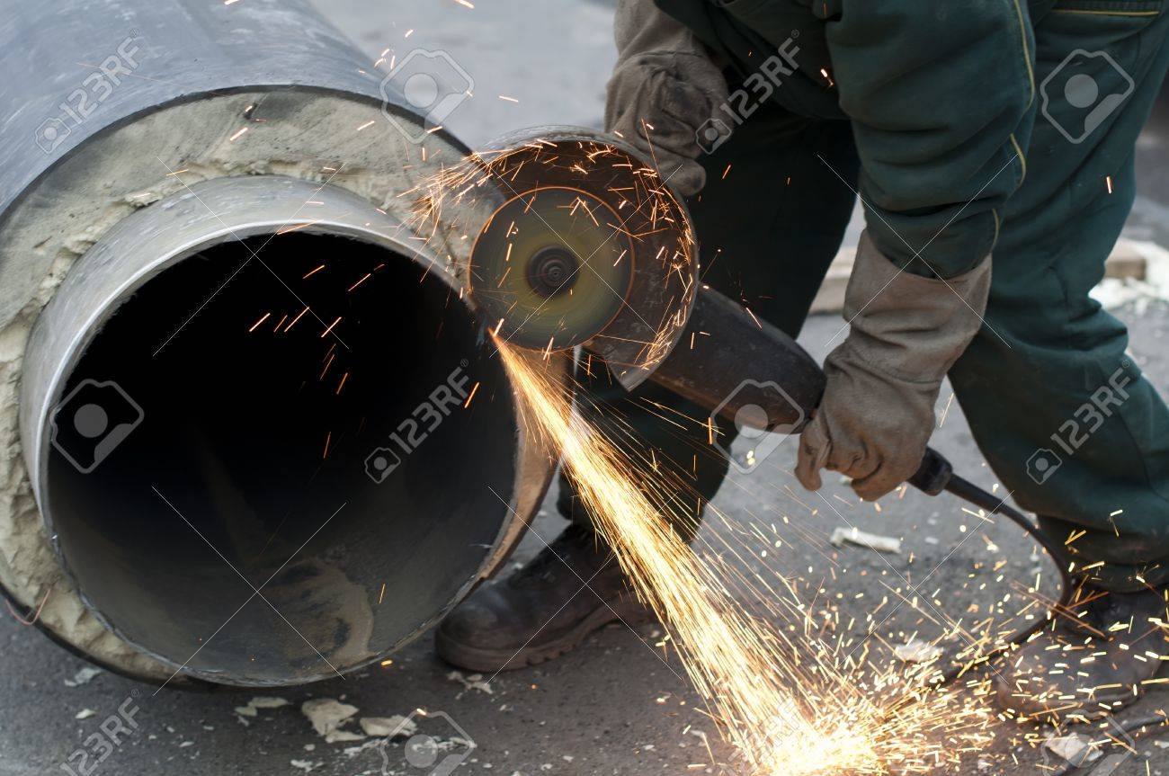 Cutting of pipes with grinder. Hot water and steam heating pipe Stock Photo - 11343833